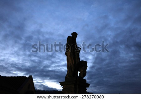 Baroque statue of Saint Nicholas of Tolentino by sculptor Jan Bedrich Kohl (1708) on the Charles Bridge in Prague, Czech Republic.  - stock photo