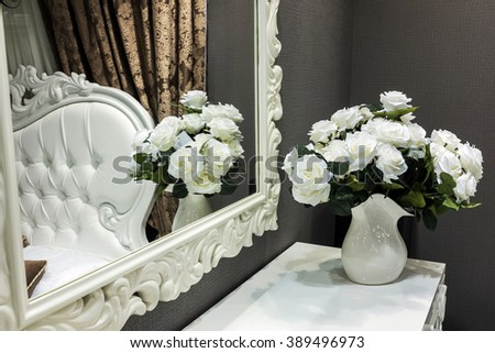 Baroque white vintage mirror in luxury bedroom