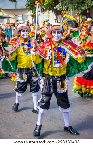 BARRANQUILLA, COLOMBIA - FEBRUARY 15, 2015: Performers with colorful and elaborate costumes participate in the Great Parade of Carnaval dePerformers with colorful and elaborate customs participate in - stock photo