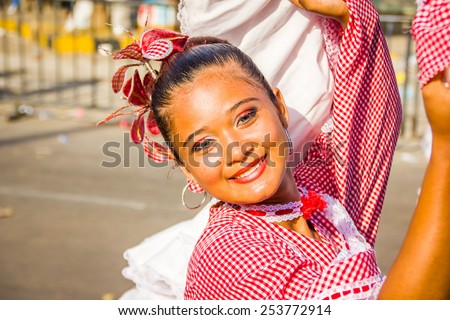 BARRANQUILLA, COLOMBIA - FEBRUARY 15, 2015: Performers with colorful and elaborate costumes participate in the Great Parade of Carnaval , smiling woman - stock photo