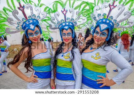 BARRANQUILLA, COLOMBIA - FEBRUARY 18, 2015: Three colombian girls dancers with colorful and elaborate costumes participate in Colombia's most important folklore celebration was declared a 'Masterpiece