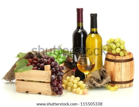 barrel, bottles and glasses of wine and ripe grapes isolated on white - stock photo
