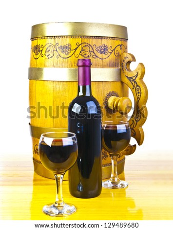 barrel, bottles and two glasses of wine isolated on white - stock photo