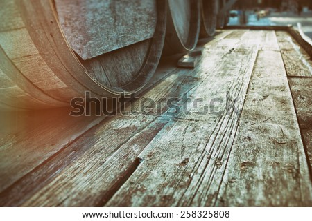 Barrel Casks Wood. Old barrel liquor casks outdoors during winter, wood with copy space. Slight vintage filter added. - stock photo