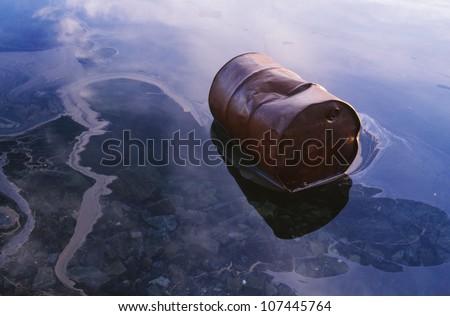 Barrel lying in water - stock photo