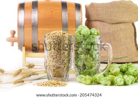 Barrel mug with hops. Isolated on a white background. - stock photo