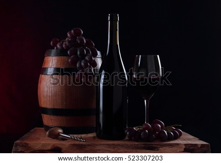 Barrel of vine, bottle with red vine, glass and fresh grapes