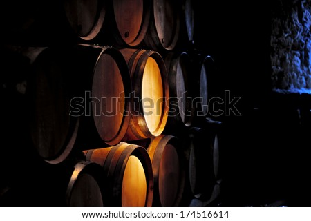 Barrel of wine in old winery. - stock photo