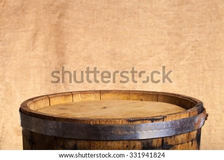 Barrel of wine on burlap background. - stock photo