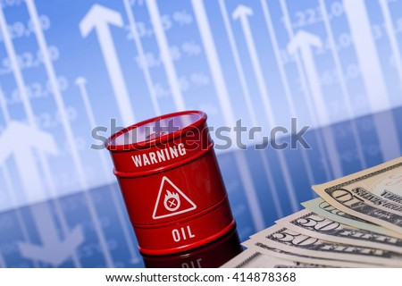 barrel oil and dollars on the blue chart - stock photo