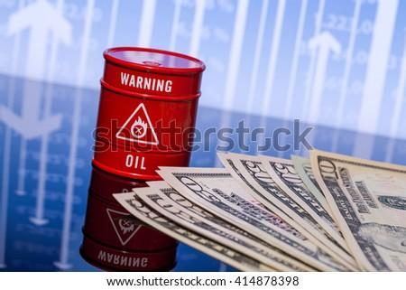barrel oil, dollars on blue chart - stock photo