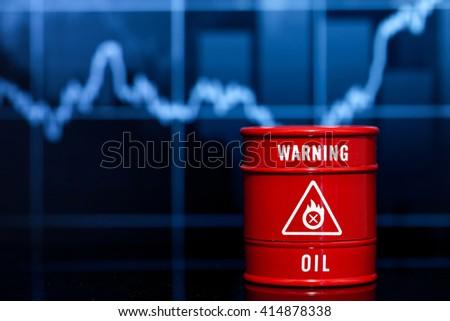 barrel oil on blue chart - stock photo