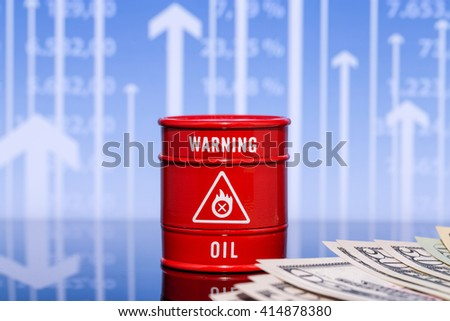 barrel oil with dollars on blue chart - stock photo