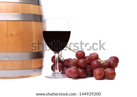 barrel, ripe grapes and glass of wine