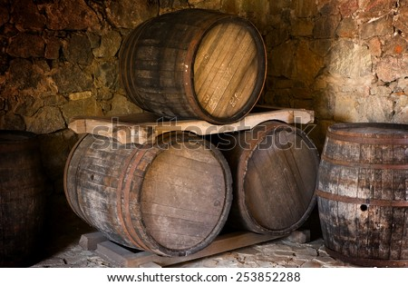 Barrel store in dark curing cellar - stock photo