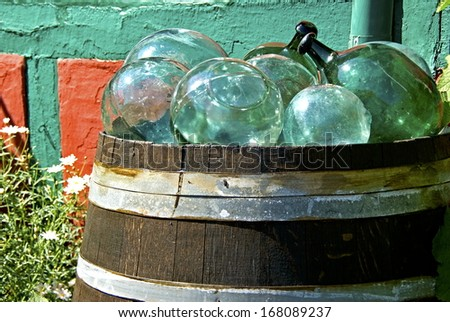 Barrel with stained glass balls used as floats on the nets by the fishermen.
