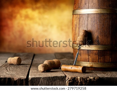 Barrel with wine and corkscrew on a wooden table - stock photo