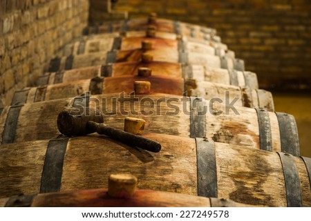 Barrels in Hungarian Wine Cellar with Maul - stock photo