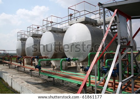 Barrels of gas in refinery plant - stock photo