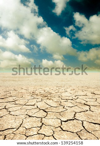 Barren ground on clouds sky. - stock photo