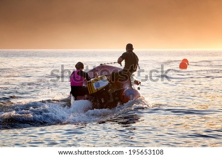 BARRENJOEY,AUSTRALIA - MAY 25,2014: Surf lifesavers practice their boat drills in Pittwater Estuary. Surf Live Saving Australia has 300+ clubs with nearly 170,000 members, most of whom are volunteers. - stock photo