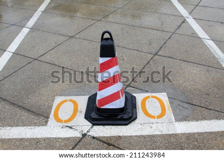 barricade warning cones on the ground in the street, closeup of photo