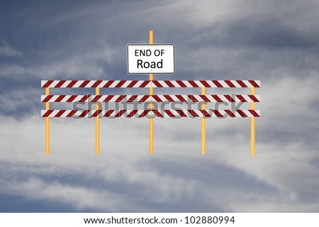 Barricade with End of Road Sign Against Blue Sky - stock photo