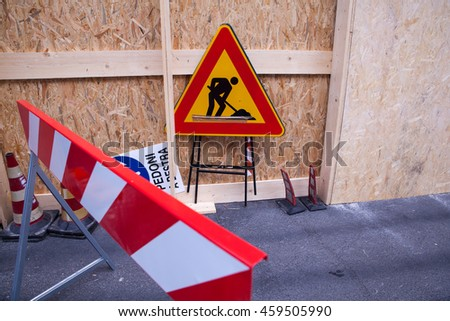 Barrier and warning sign at construction site - stock photo