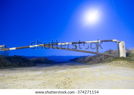 barrier in the moonlight night - stock photo