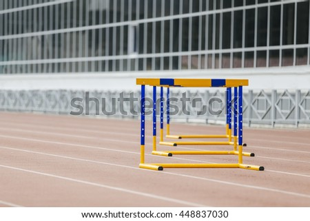 barriers at stadium for a run at 400 meter hurdles - stock photo