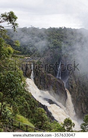 Barron Falls is a tiered cascade  waterfall on the Barron River near Cairns Queensland Australia