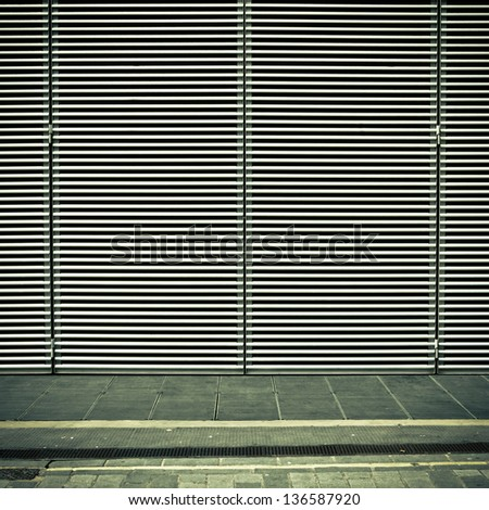 Bars and a pavement in muted tones as a background - stock photo