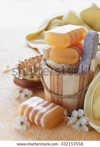 bars of glycerin soap and hygiene items on a yellow background. health care and hygiene concept. selective focus