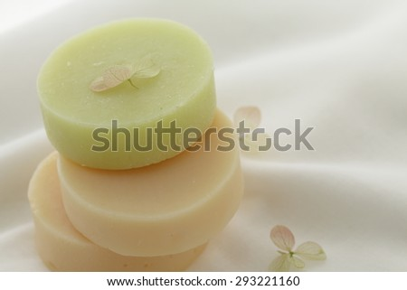 Bars of natural handmade soap on white cloth - stock photo