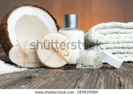 Bars of soap, coconut  and face cream-spa setting - stock photo