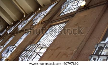 Bars shown on the windows of Jail.  Prison windows shot on Alcatraz Island in San Francisco, California. - stock photo