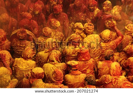 BARSANA - MAR 21: People celebrate the traditional and a ritualistic Holi at Radharani temple on March 21, 2013 in Barsana, India. Holi is the most celebrated and colorful festival in India.