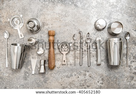 Bartender equipment for making cocktail. Shaker, jigger, strainer, spoon. Food and beverages concept - stock photo