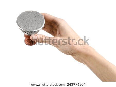 Bartender holding a clay bowl with tobacco for hookah covered with a foil with holes isolated on a white background - stock photo