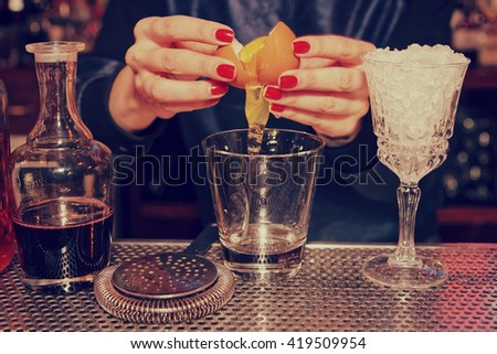 Bartender is adding egg white to the glass, toned image - stock photo
