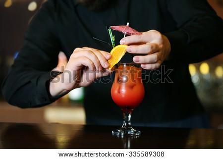 Bartender making cocktail - stock photo