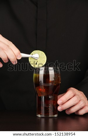 Bartender making cocktail on bright background, close-up - stock photo