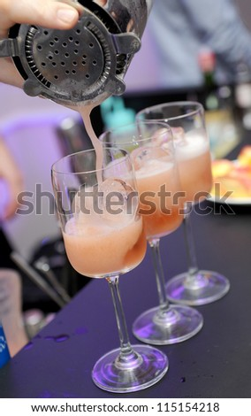 bartender mixes cocktail - stock photo