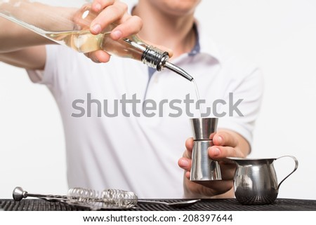 bartender preparing coctail with bar equipment, studio shoot - stock photo