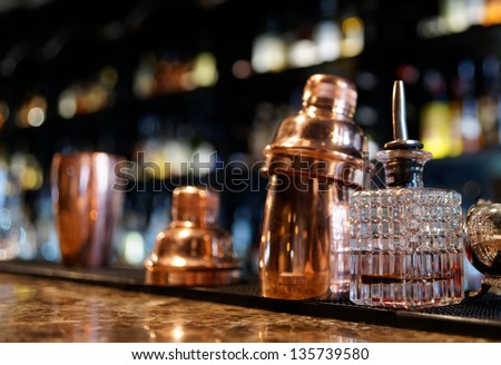 Bartender tools on old style bar counter - stock photo