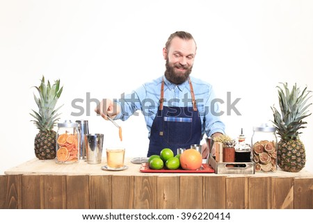 bartender with a shaker and bottle on white background. behind the bar - stock photo