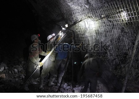 BARTIN-APRIL 5 : Unidentified Chinese mine workers began working in Turkey on April 5, 2014 in Bartin,Turkey. - stock photo