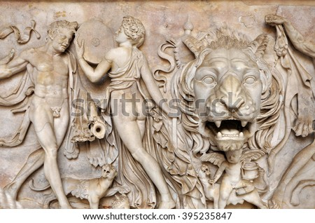 Bas-relief and sculpture of ancient Roman Gods and a lion head