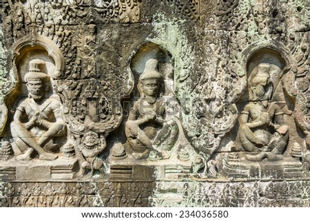 Bas-relief at the ancient temple of Angkor Wat, Cambodia - stock photo