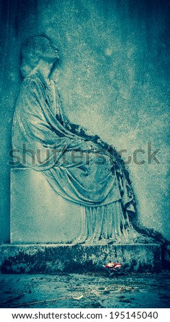 Bas-relief depicting a mourning young woman on headstone at  Montparnasse Cemetery in Paris (France) Aged photo. - stock photo